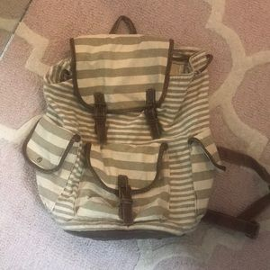 Striped backpack purse with leather detailing